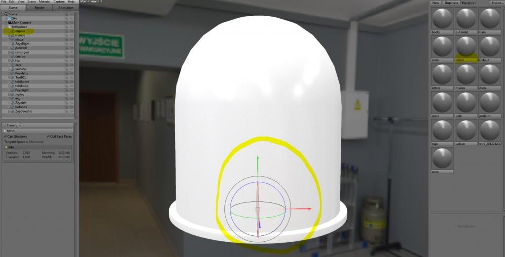 """Siempre que señalamos un objeto en la escena este aparece con un recuadro en el """"inspector"""" de items. Además de los gizmos para las transformaciones observamos que nuestro objeto viene con el material ya asignado y listo para editar. En la lista del inspector de items vemos que al lado derecho del nombre hay un símbolo de ojo que usaremos para ocultar la geometría de la cúpula y así poder ver el resto d elos objetos hasta haber asignado el cristal."""